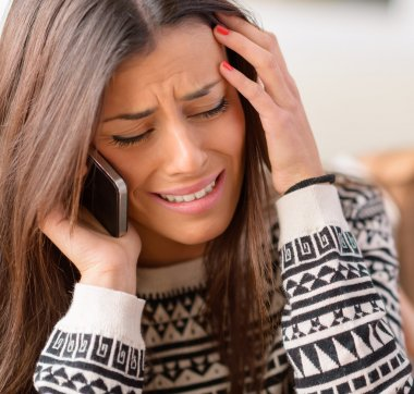 Young Woman Crying On Cell Phone