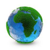 Fényképek Miniatűr zöld föld bolygó