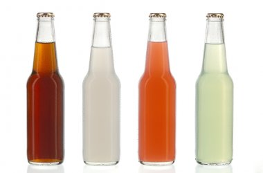 Four assorted soda bottles, alcoholic drinks with water drops