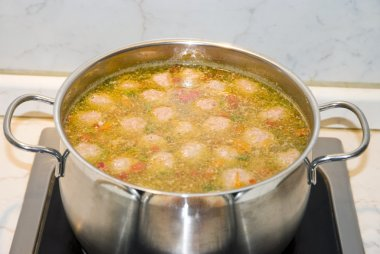 soup with meatballs in pan