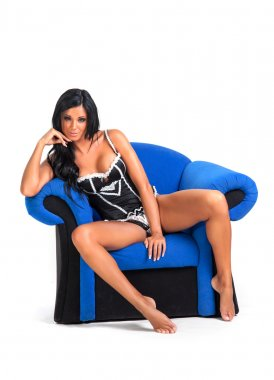 Sexy young woman sitting in provocative pose - isolated