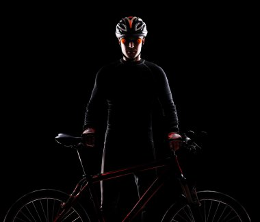 Low key silhouette of a cyclist