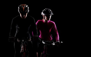 Cyclists on black background