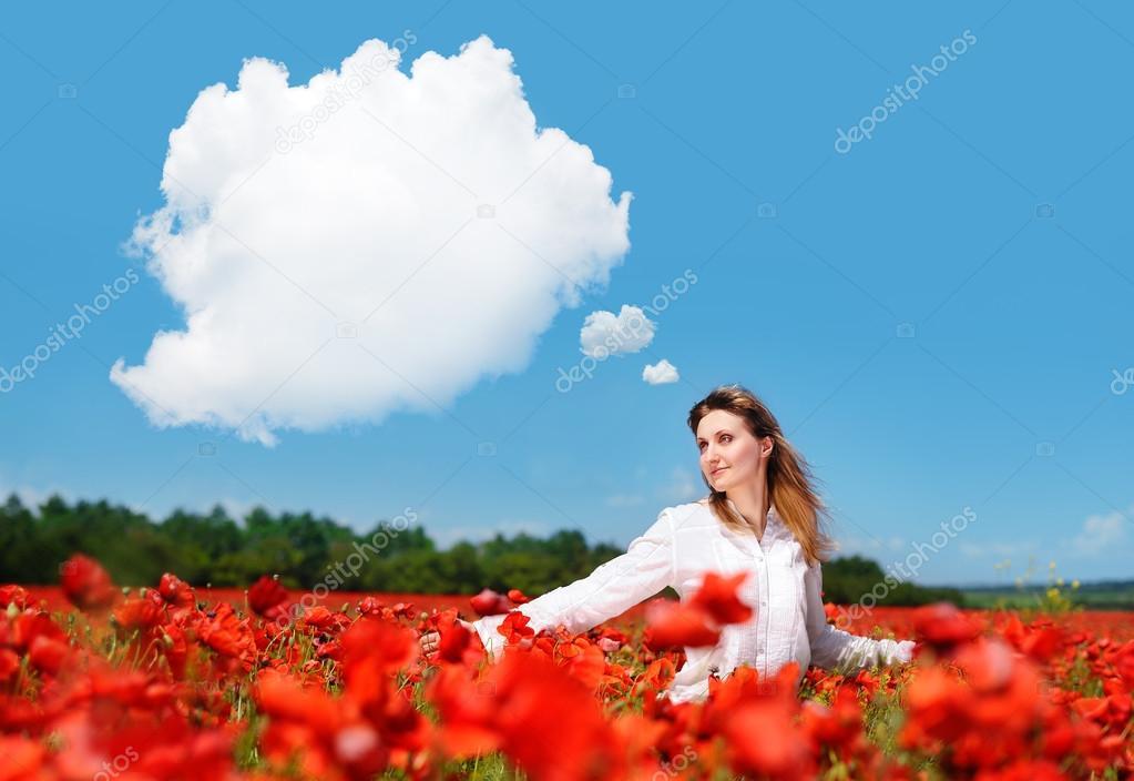Beautiful girl in a poppy field