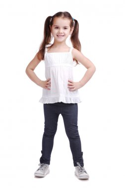 Full length portrait of a happy little girl standing on white background