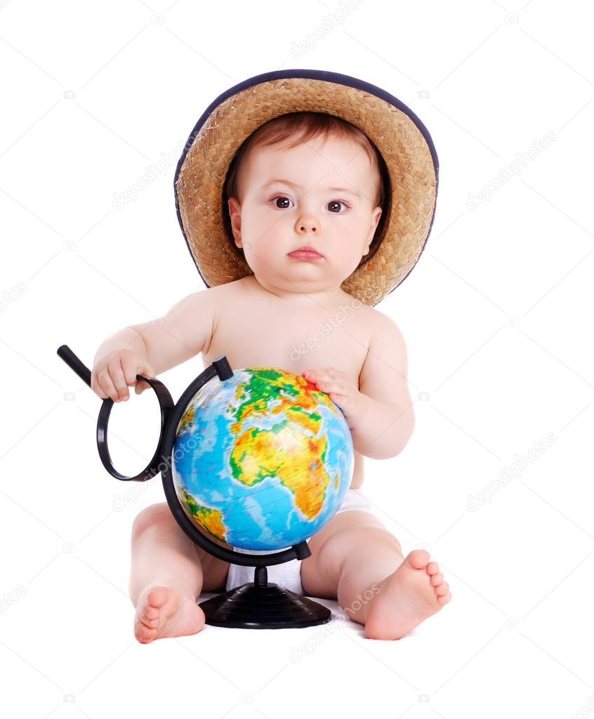 Baby boy holding the magnifier glass and the globe