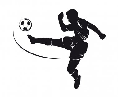Silhouette of a football player kicking the ball