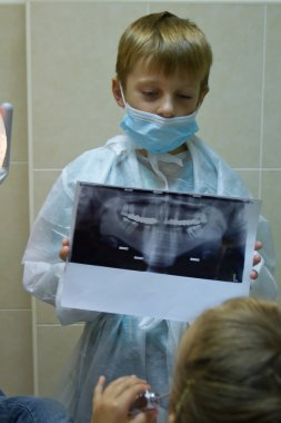 child plays in a dentist