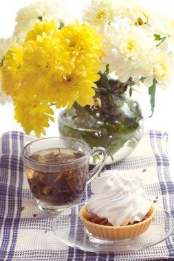 Romantic breakfast. Tea, cake, chrysanthemum