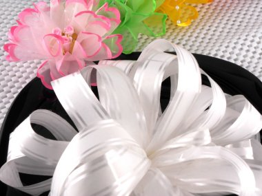 Floral pattern gift box tied with white ribbon