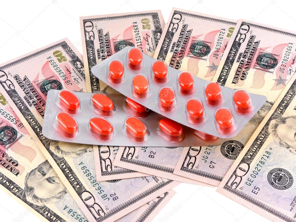 Medical pills on dollars bank note as symbol for high costs stock medical pills on dollars bank note as symbol for high costs stock photo buycottarizona Gallery