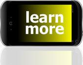 Fotografie chytrý telefon s učit další slovo, obchodní koncept