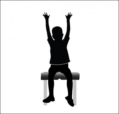 boy sitting on chair with hands up