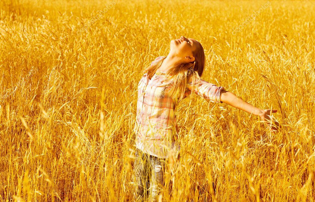 Female on wheat field