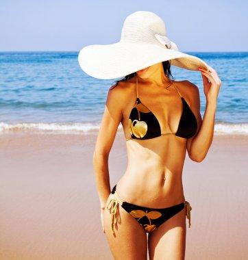Perfect female on sea coast