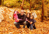 Fotografie Cheerful family in autumn woods
