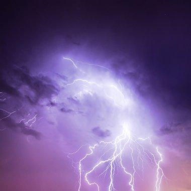 Lightning in purple sky