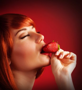 Seductive female with strawberry