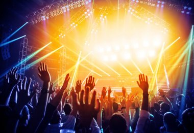 Photo of young people having fun at rock concert, active lifestyle, fans applauding to famous music band, nightlife, dj on the stage in the club, crowd dancing on dancefloor, night perfomance stock vector