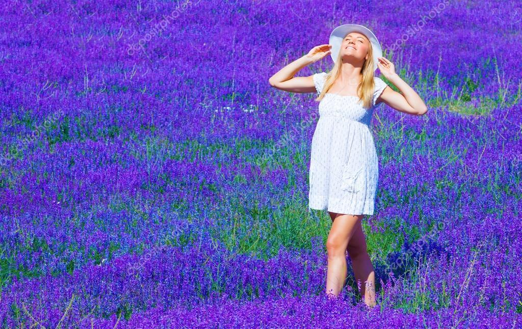 Cute girl enjoy lavender meadow