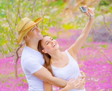 Cute couple photographing of themself