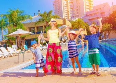 Happy family near pool