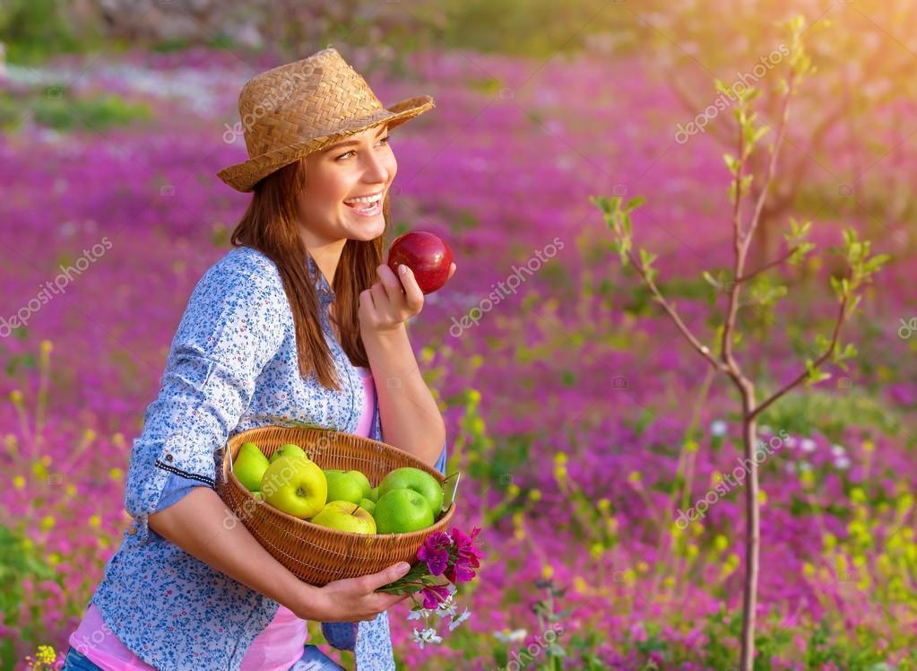 Happy woman eating apple