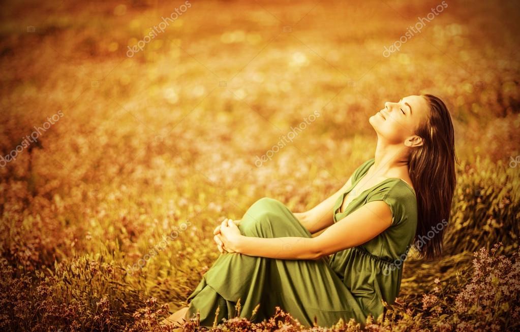 Romantic woman on golden field