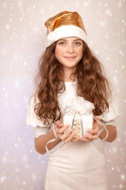 Pretty girl holding gift box