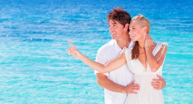 Happy couple enjoying beach