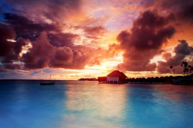 Sunset over Maldives islands