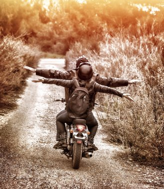 Riding on motorbike with pleasure