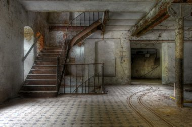 Old staircase in an abandoned hall