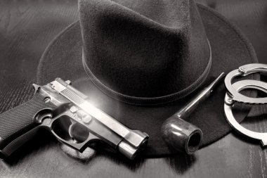 detective team, semiautomatic pistol handcuffs hat and pipe