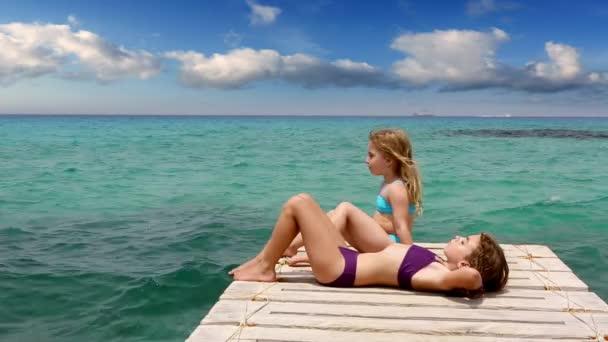 Little sisters girls looking idyllic landscape in formentera beach