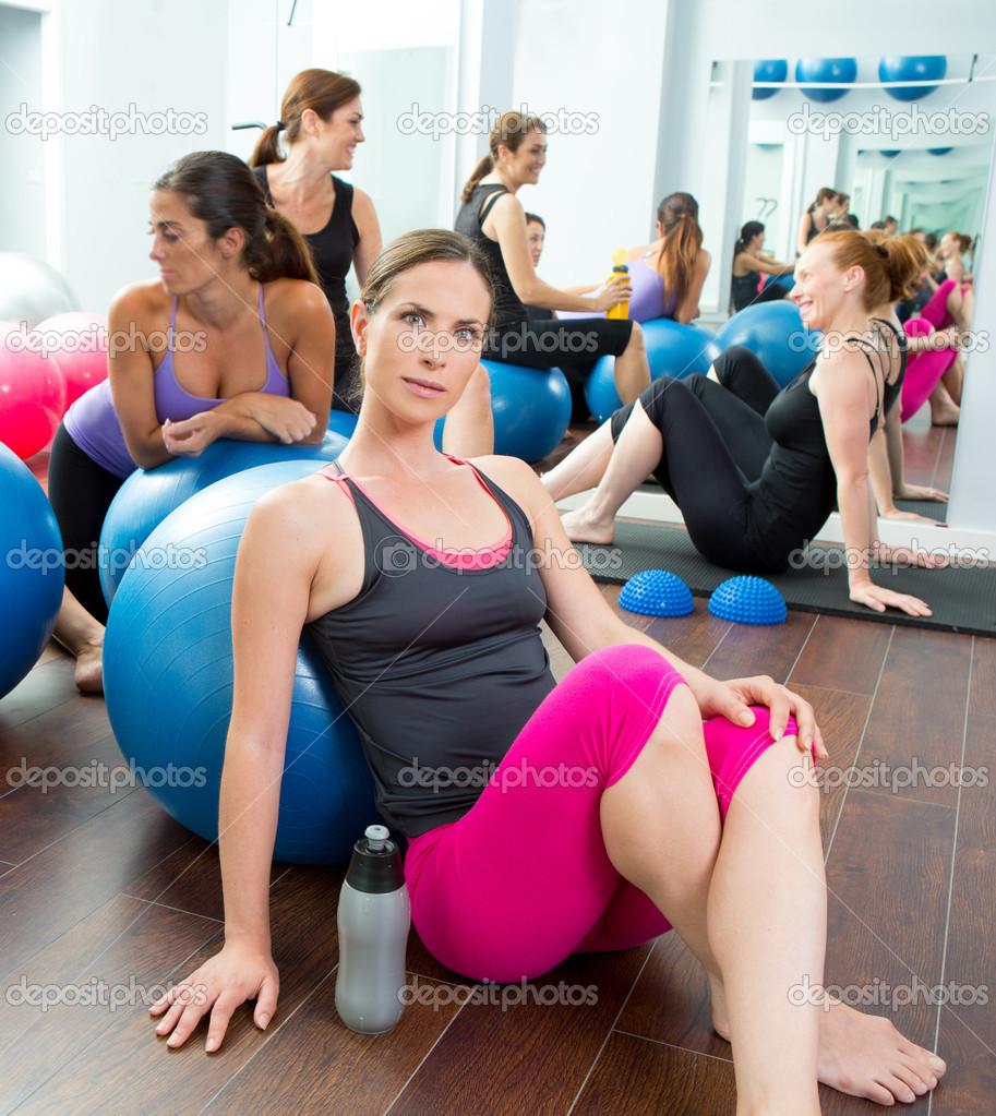 aerobics pilates women group having a rest at gym stock photo