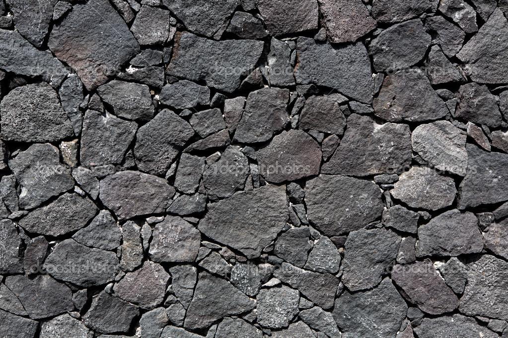 Parete in muratura di pietra vulcanica nera lava — Foto Stock © lunamarina #13306766