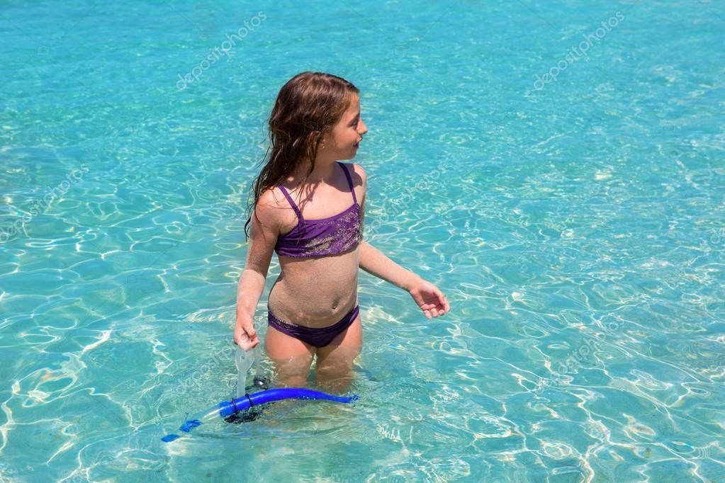 aqua water beach and purple bikini little girl