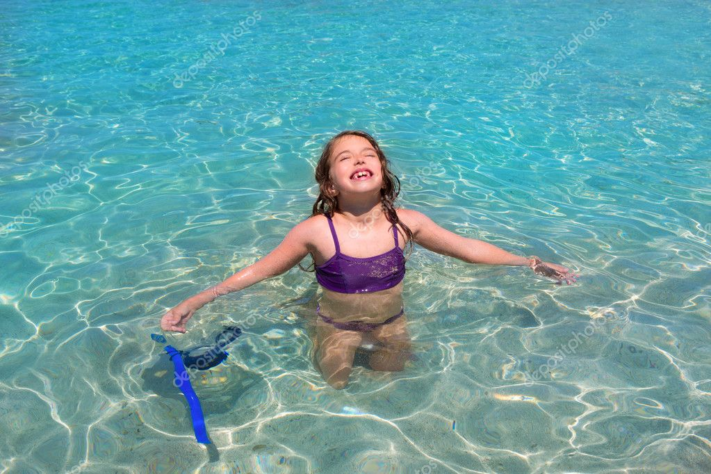 aqua water beach and open arms bikini little girl