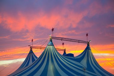 Circus tent in a dramatic sunset sky colorful