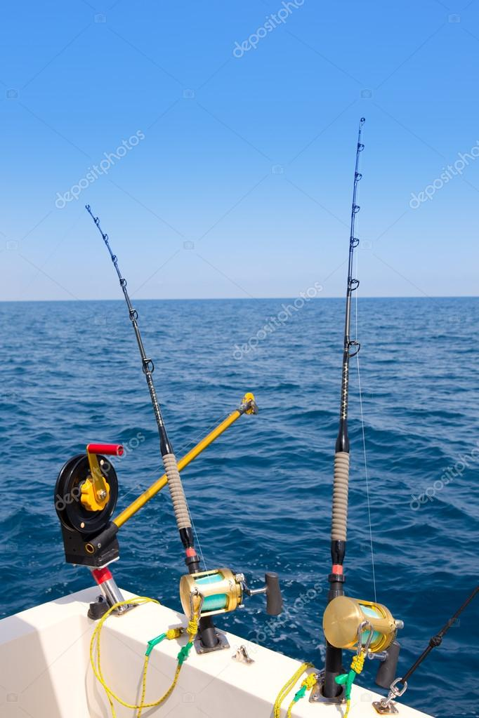 boat trolling fishing gear downrigger and two rods