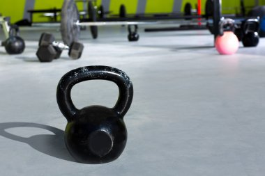 Kettlebell at crossfit gym with lifting bars