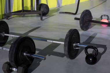 Kettlebells at crossfit gym with lifting bar weights