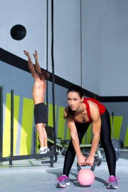 Crossfit gym Kettlebell woman and wall ball man