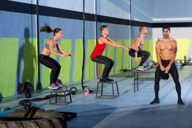 Crossfit box jump group and kettlebell man