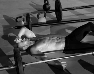 crossfit man tired relaxed after workout