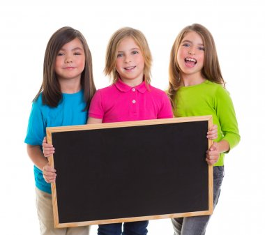 Children girls group holding blank blackboard copy space