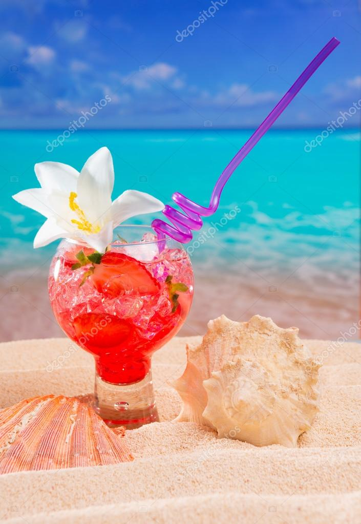 Beach tropical red cocktail on caribbean white sand flower