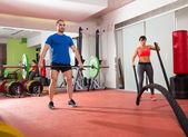 Fotografie CrossFit Gym Gewichtheben bar Mann Frau kämpft Seile
