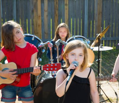 chidren singer girl singing playing live band in backyard